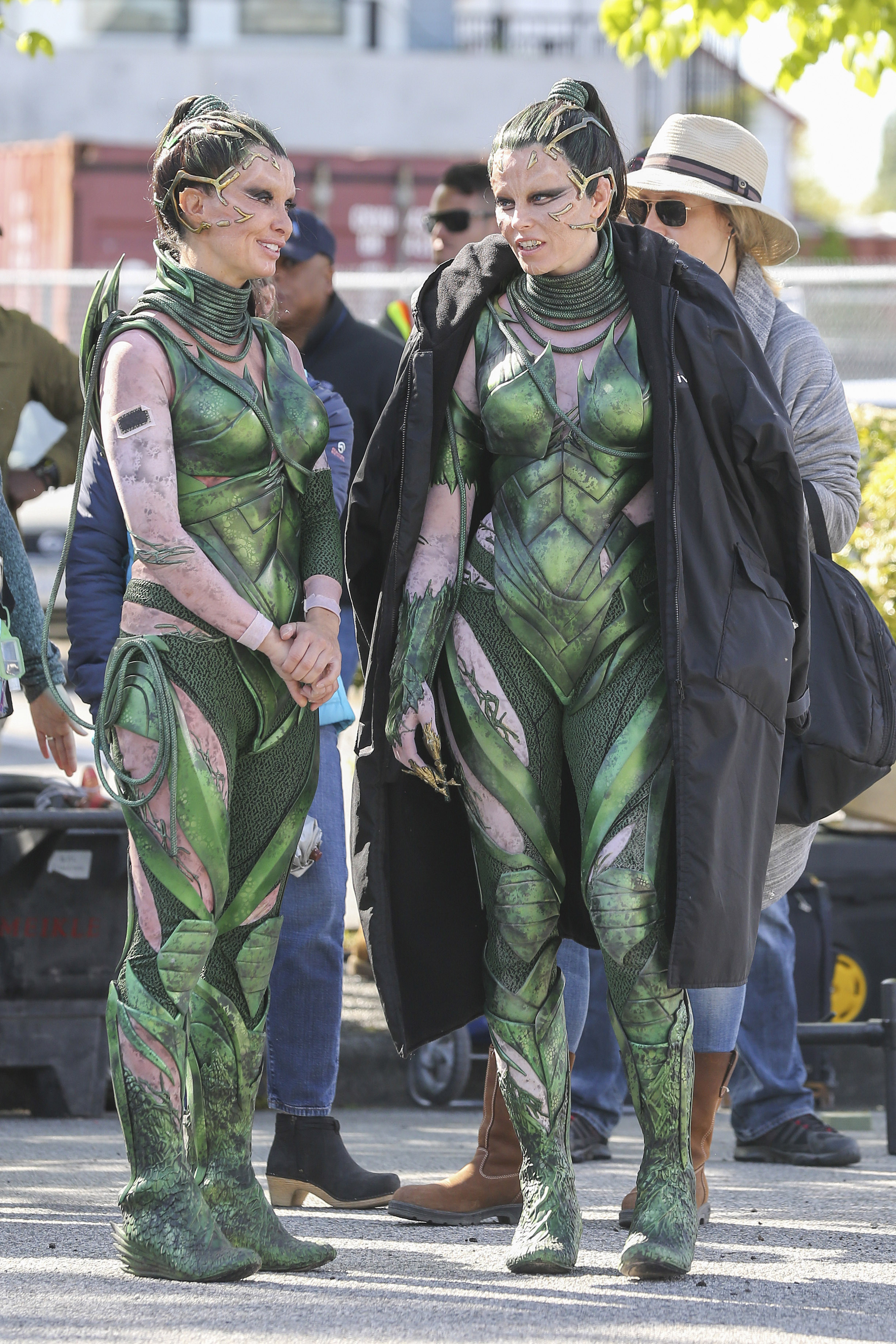 Elizabeth Banks and her stunt double wearing green costumes while filming