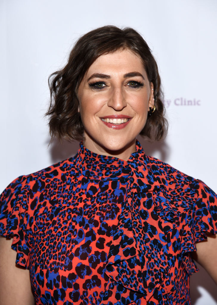 Mayim in a printed dress