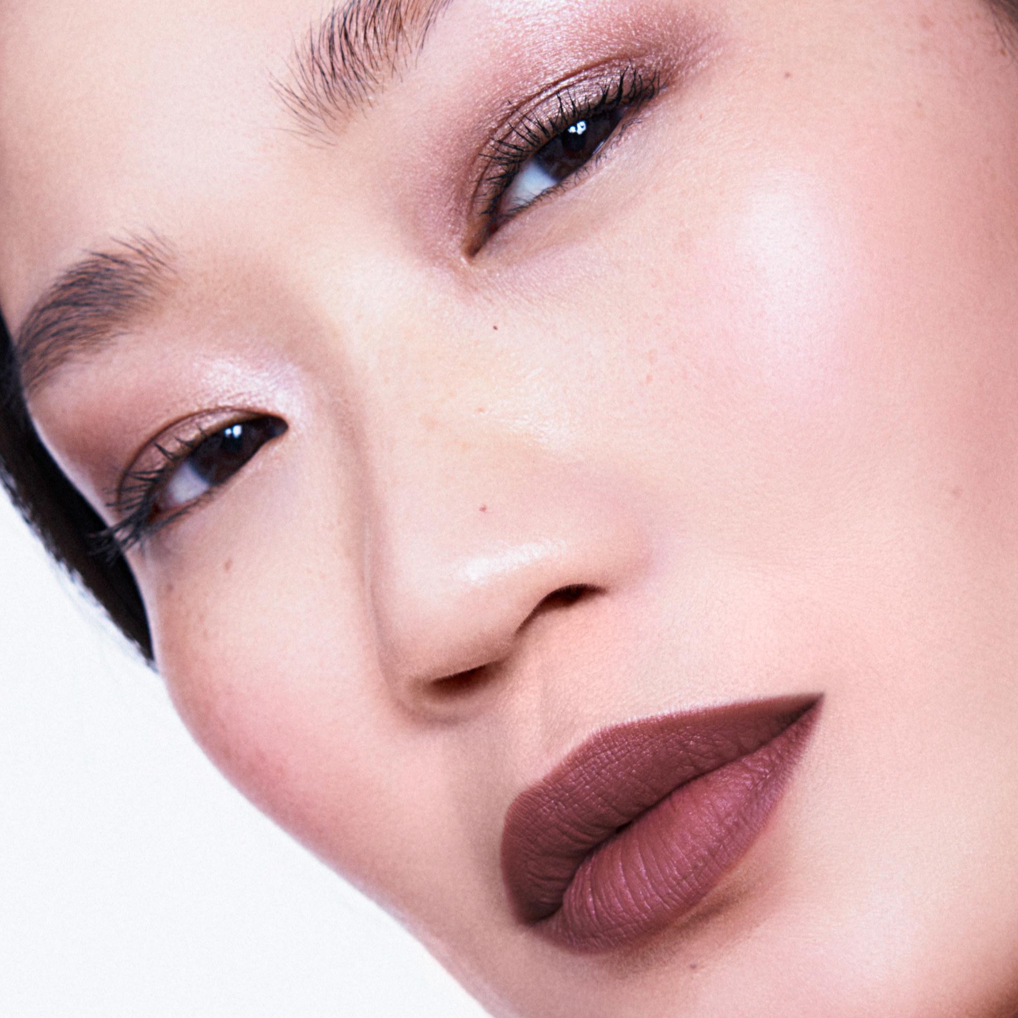 Model wearing Powderstick Matte Lip Crayon close up