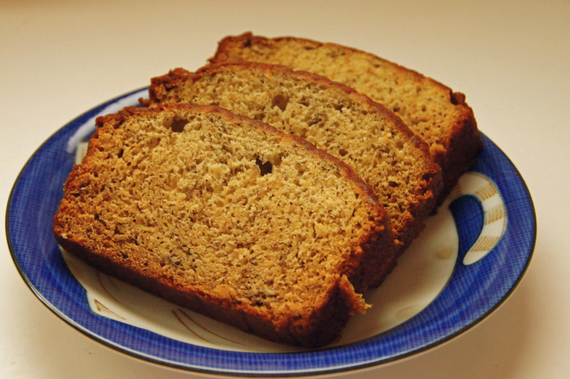 Slices of a banana bread sitting on a plate