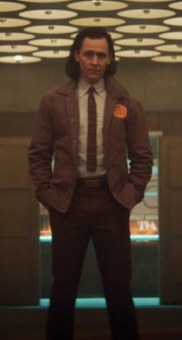he wears suit pants with his TVA coat and tie