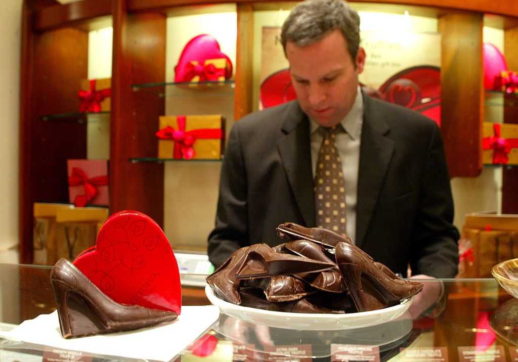 A man works in the Godiva store in the mall