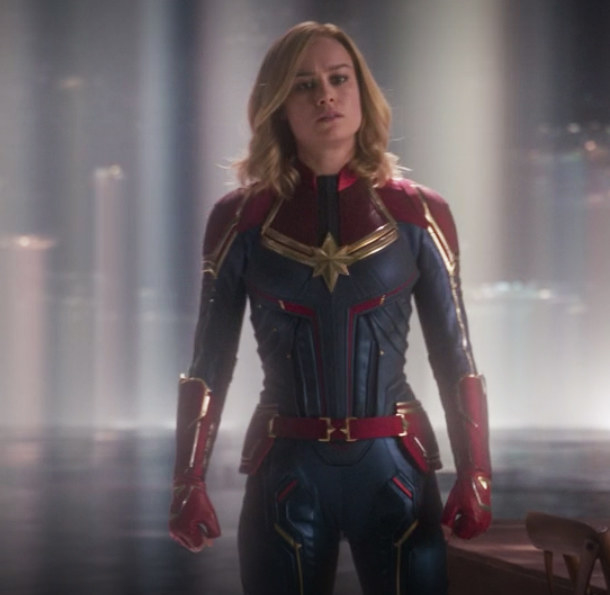 her fitted suit is two-toned and has a star on the chest