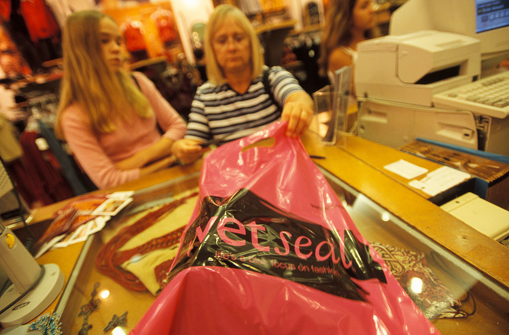 A mother and daughter shop at wet seal