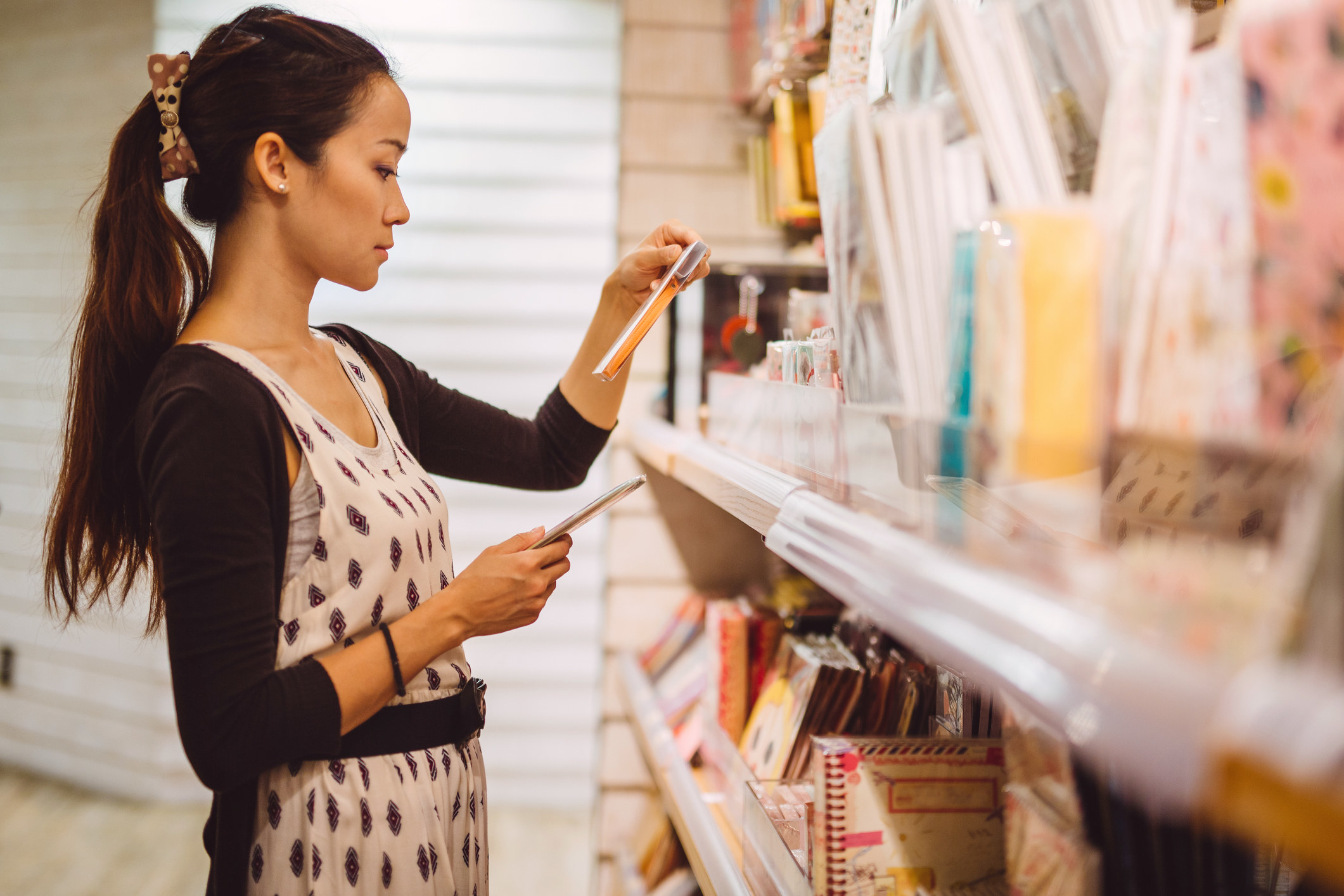 A young woman shops for greeting cards