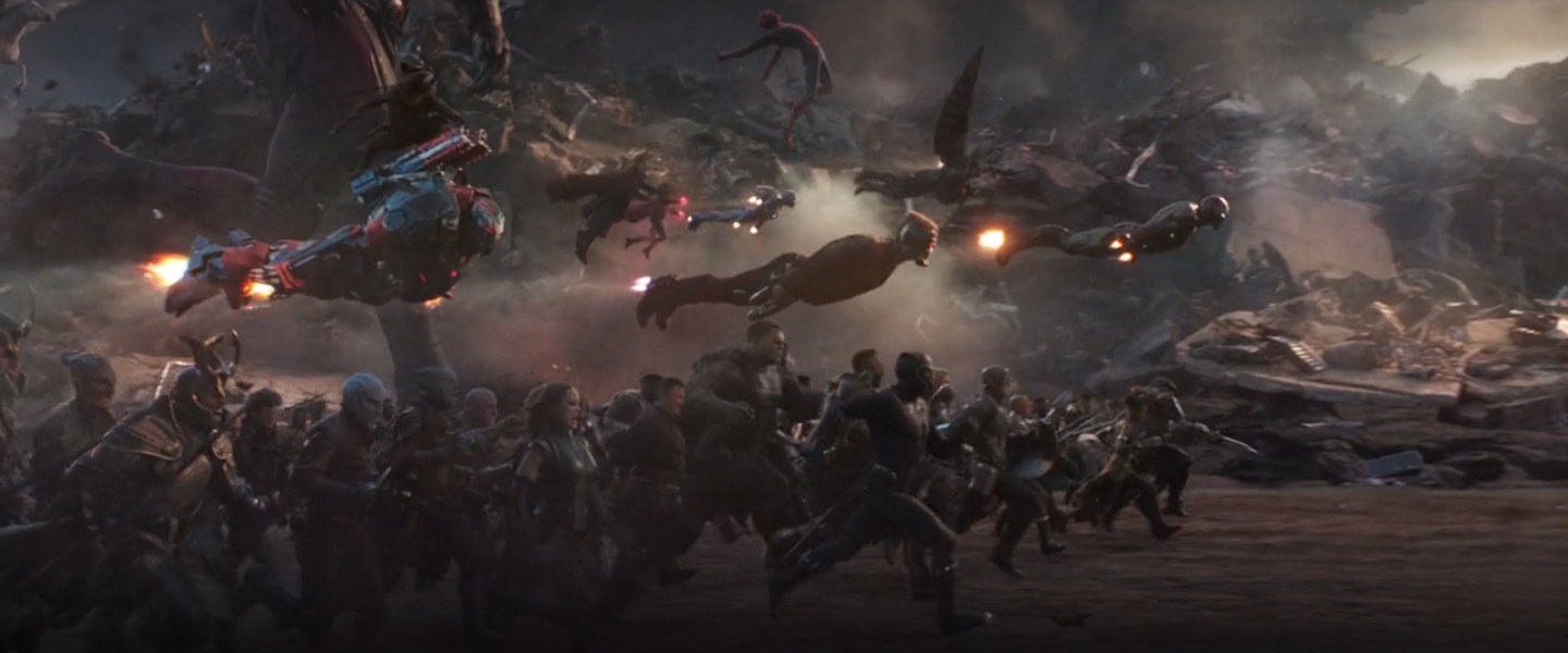 the legion of heroes stampedes towards Thanos
