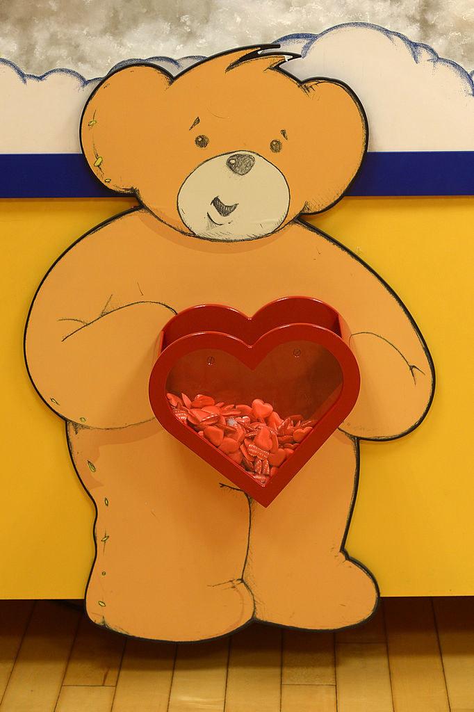 A Build A Bear holding a ton of those hearts