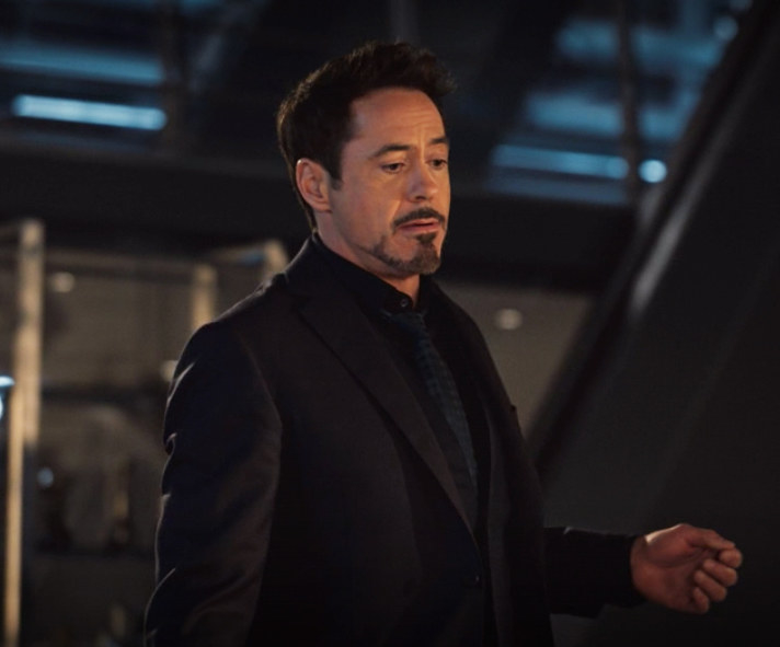 Tony's suit and tie are understated