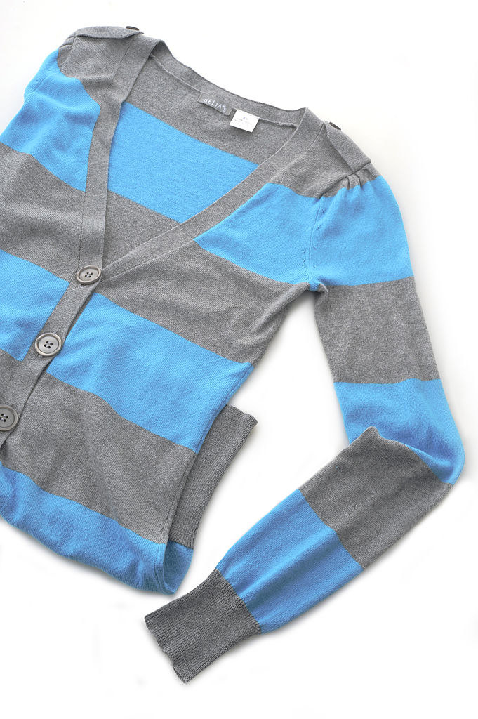 A grey and blue stripey delia's cardigan