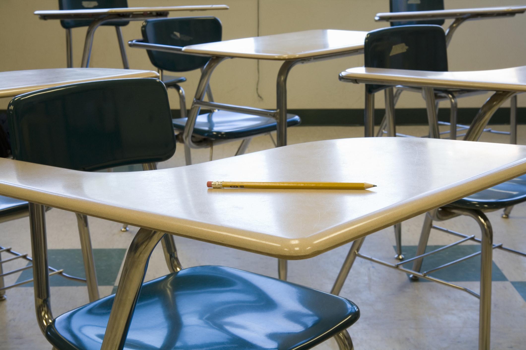 A pencil laying on a school desk