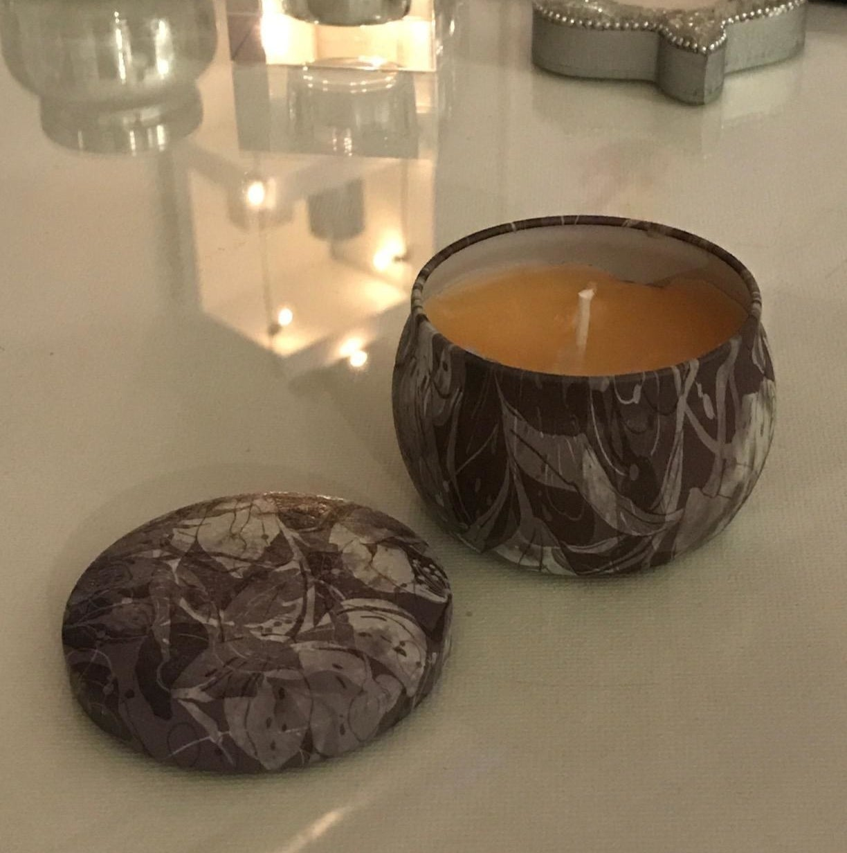 Reviewer photo of the candle tin with a candle inside
