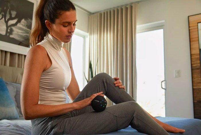 a model using the massage ball