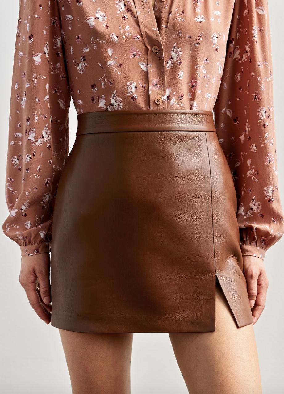 model wearing camel colored skirt
