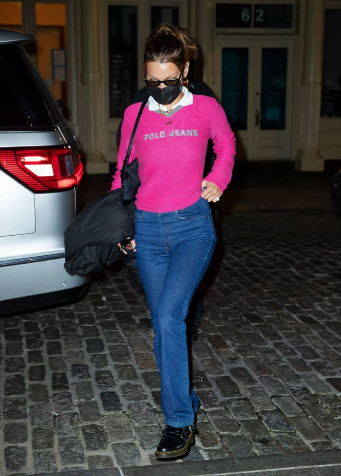 Bella Hadid in a pink sweater and jeans
