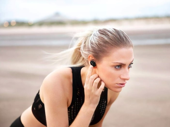 Model running with the earbuds securely in her ears
