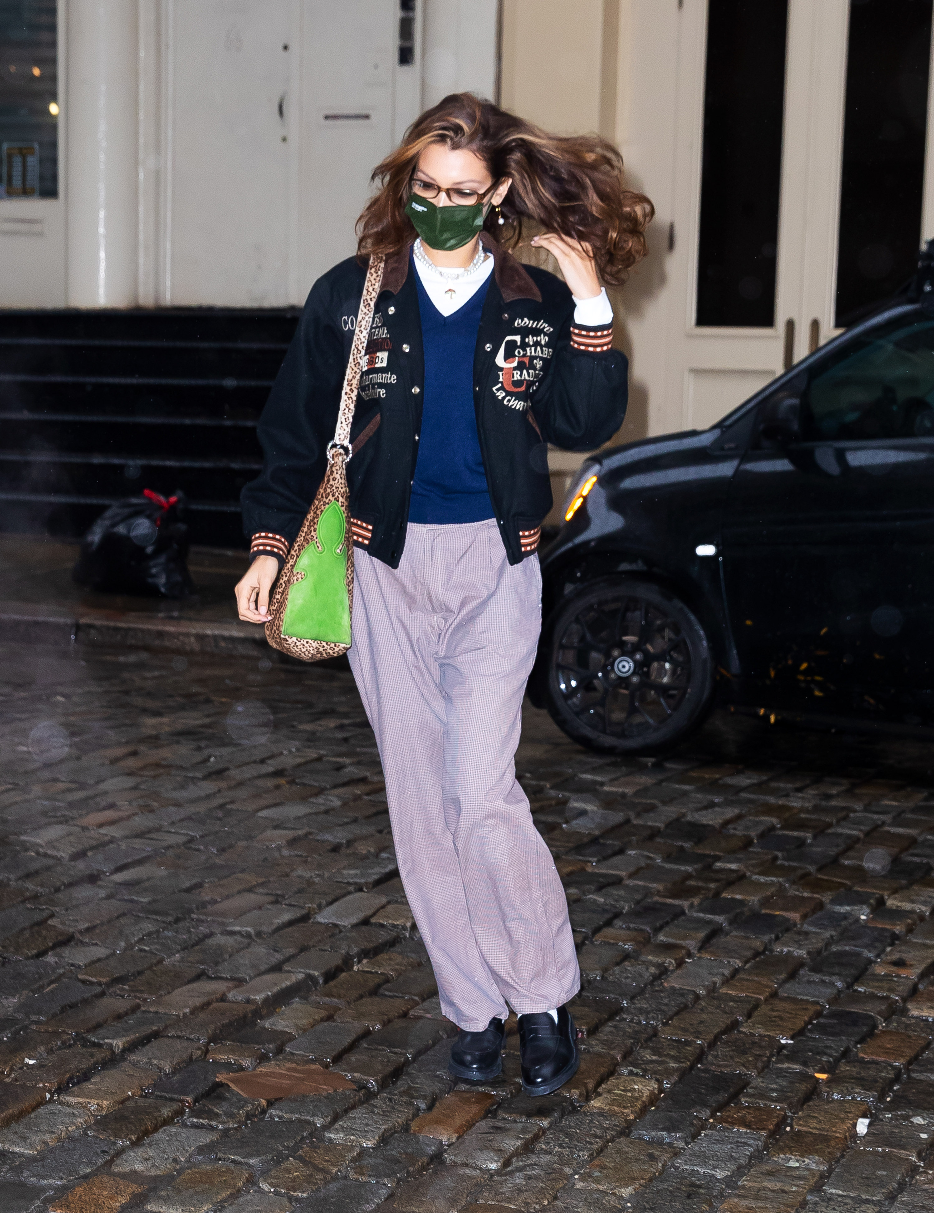 Bella Hadid in a sweater, jacket and printed pants