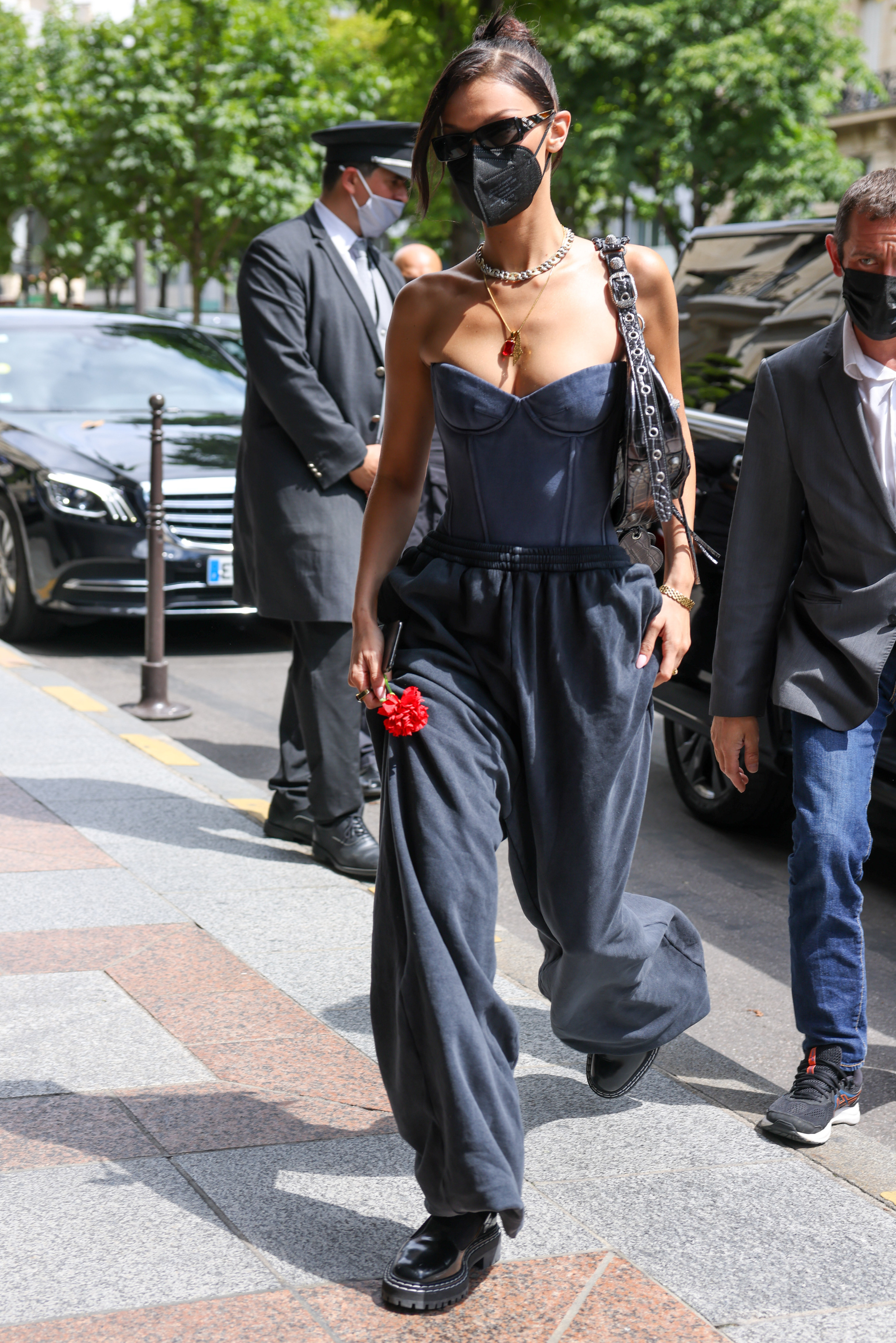 Bella arriving at her hotel wearing a denim top and oversized pants