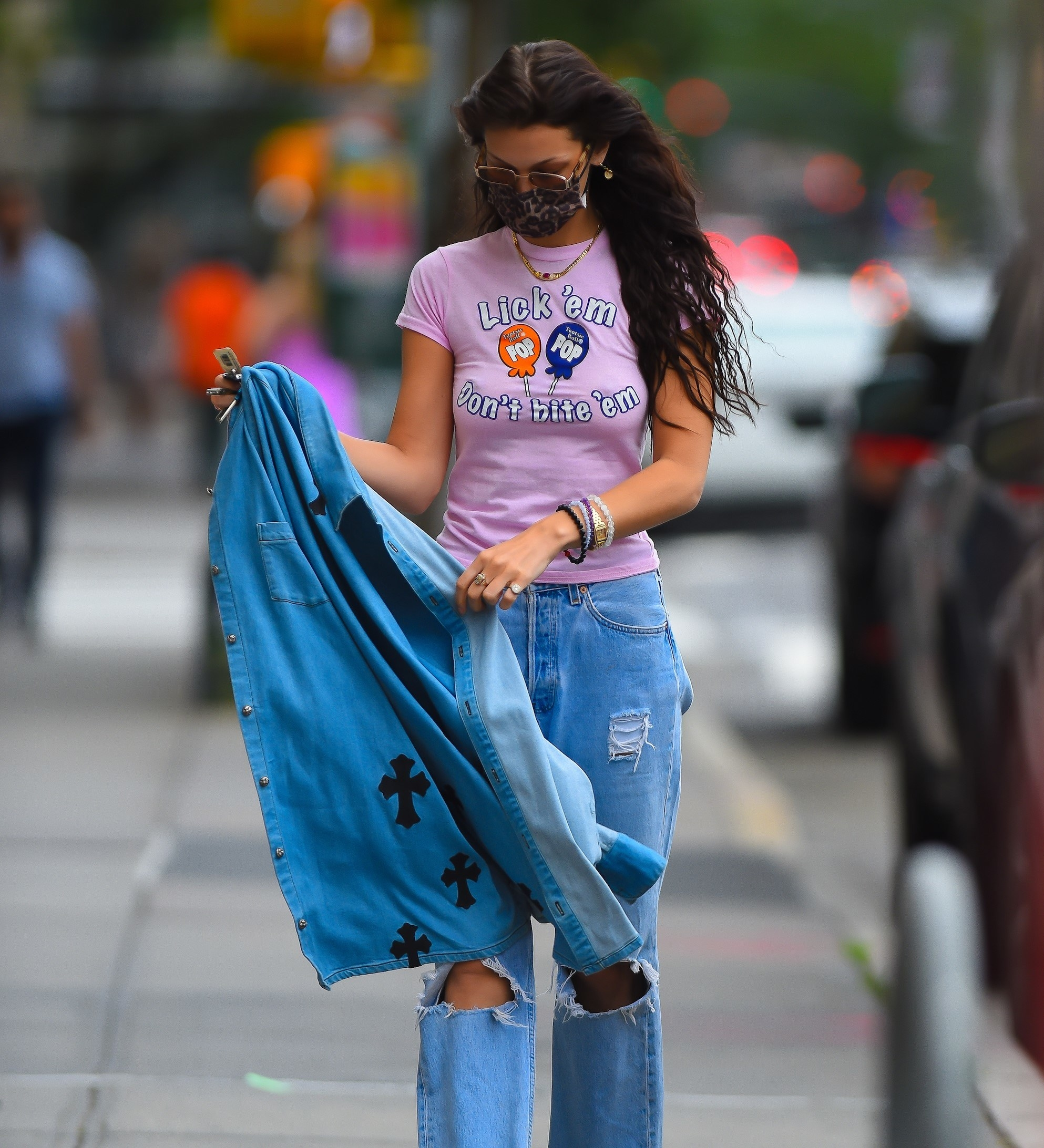 Bella Hadid in a pink tee and jeans