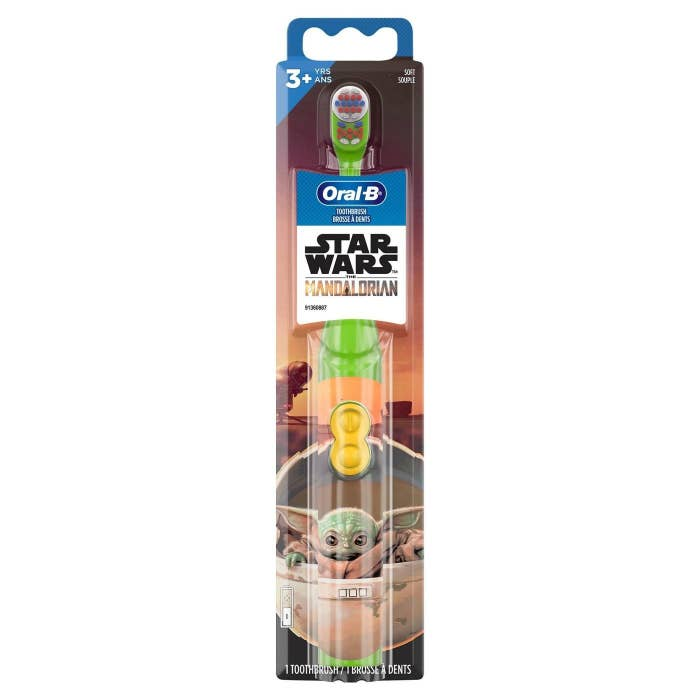 A Star Wars Mandalorian electric toothbrush with baby Yoda on it