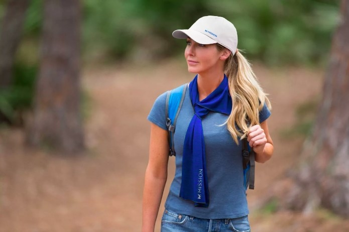 Model wearing the towel around her neck while hiking