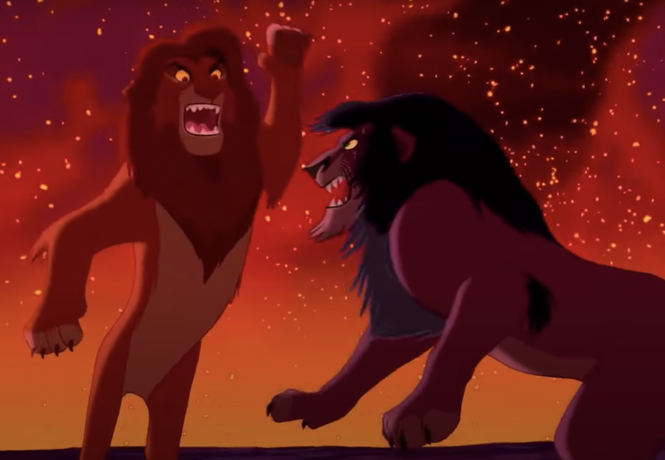 Simba leaps and attacks Scar as fire burns around them