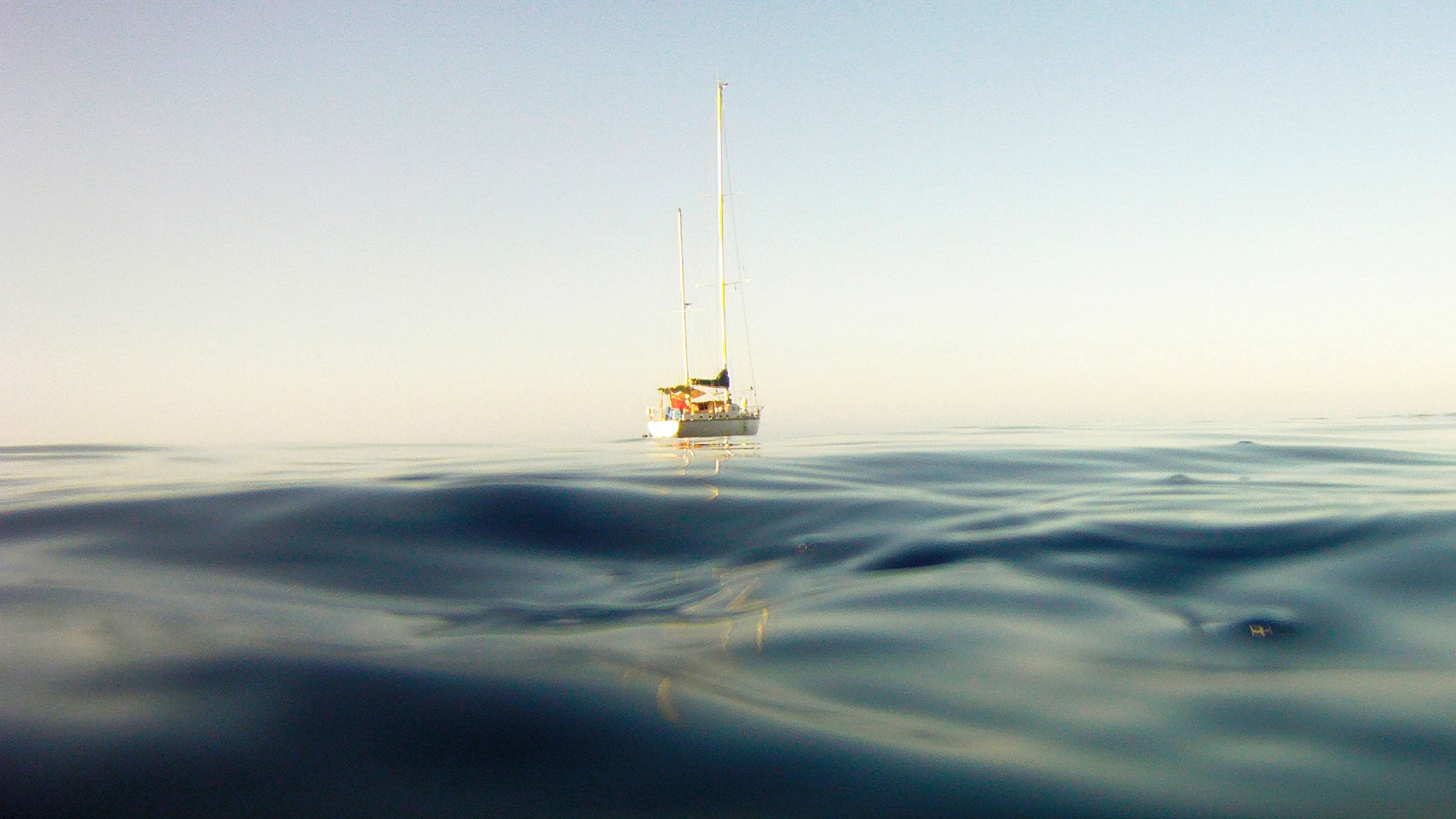 A sailboat in the middle of the ocean