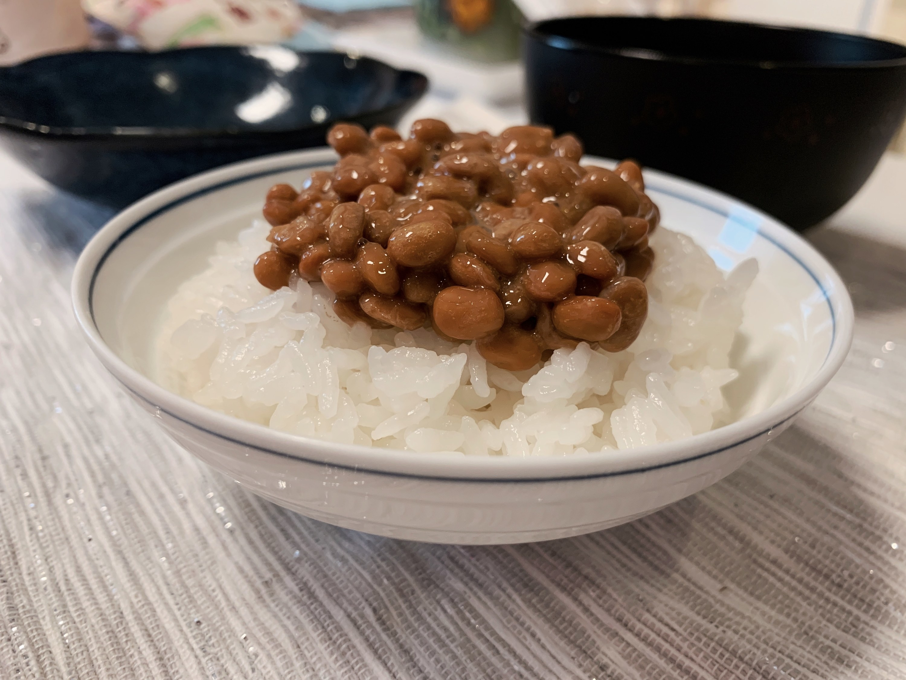 A bowl filled with rice and fermented soy beans