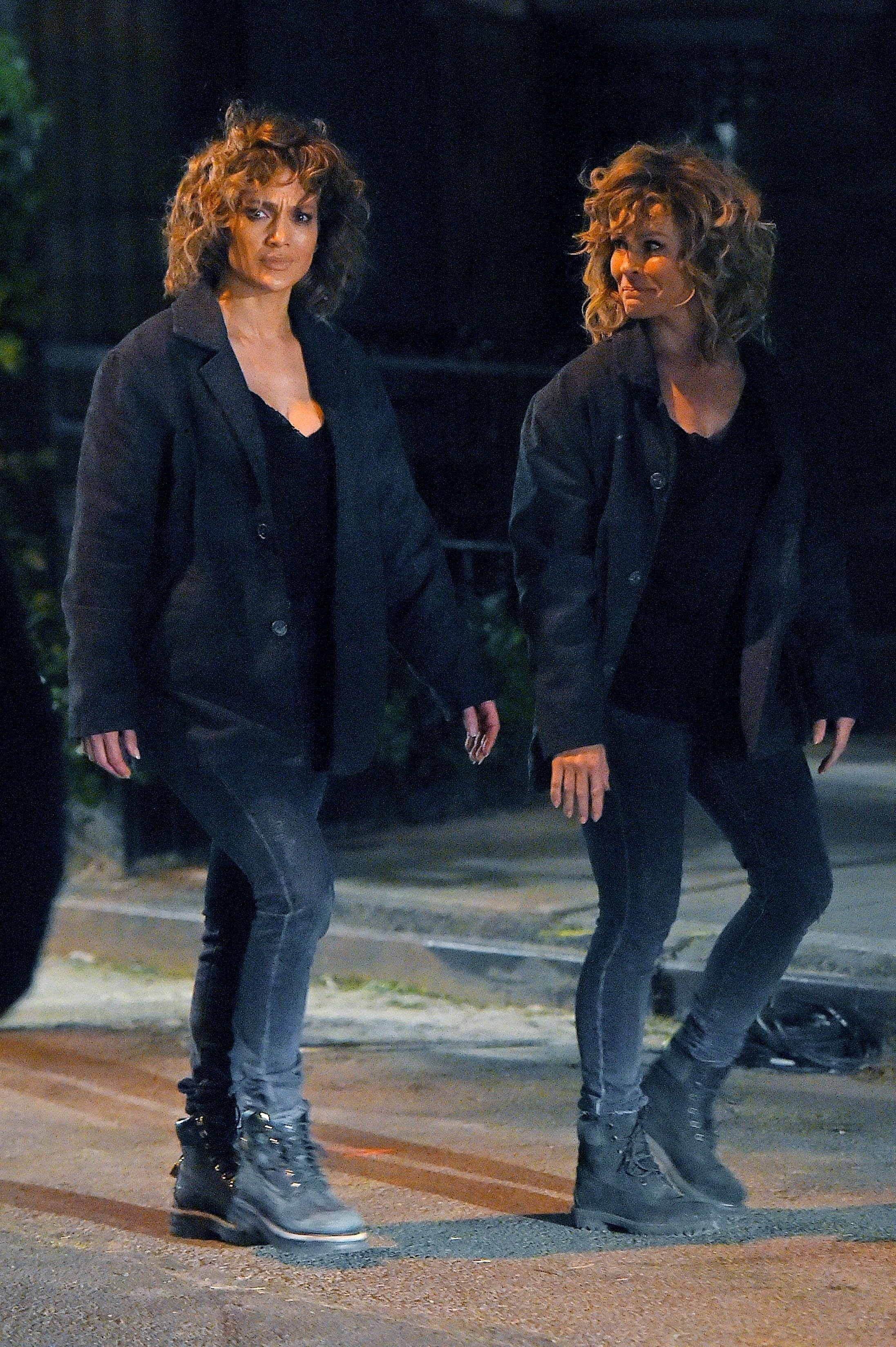 Jennifer Lopez and her stunt double walking at night