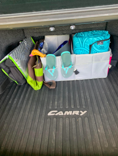 reviewer's photo of the square car trunk organizer actually in their trunk with stuff in the different compartments. Also there is so so so much empty space in their trunk that was previously covered with all the stuff.