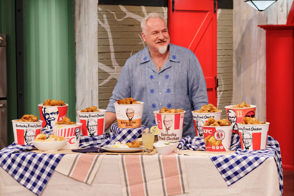 Art Smith posing with a table of KFC fried chicken