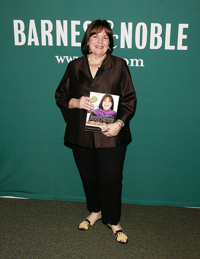 Ina Garten holding one of her cookbooks at a Barnes and Noble event