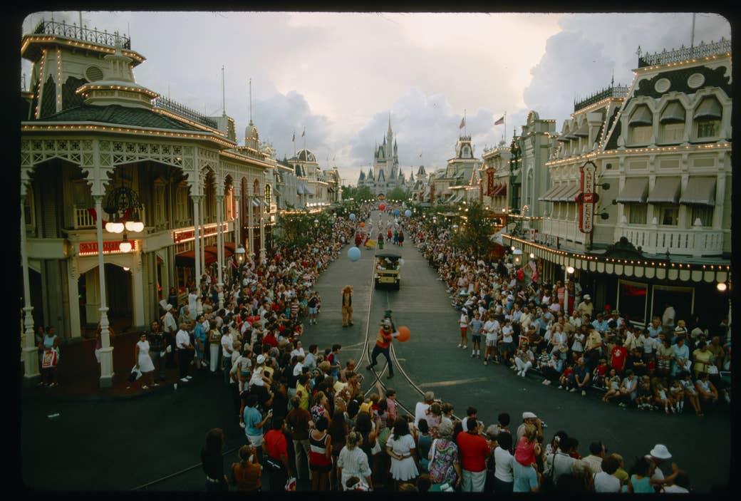 Crowds watch a parade on Main Street at Walt Disney World Resort
