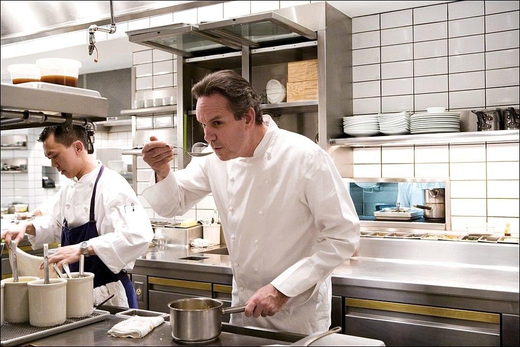Thomas Keller tasting a sauce in the kitchen