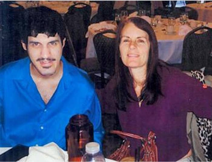 Dominic Pantoni seated at a table with his mother, Nancy Pantoni