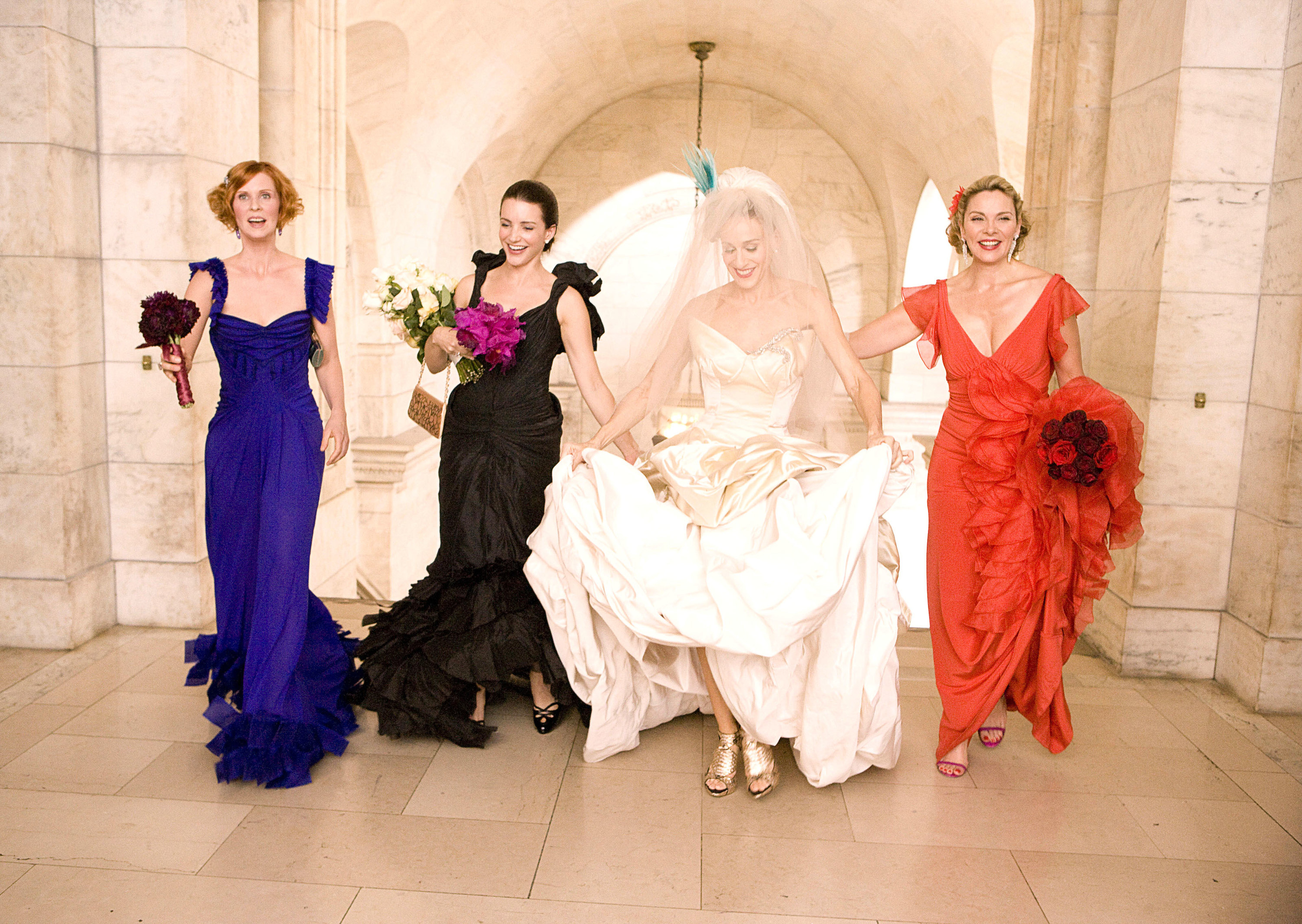 The women from Sex and the City in their formal wear for Carrie's wedding in the first movie
