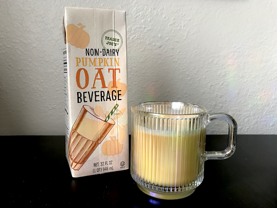 A carton of pumpkin oat beverage and a glass of it
