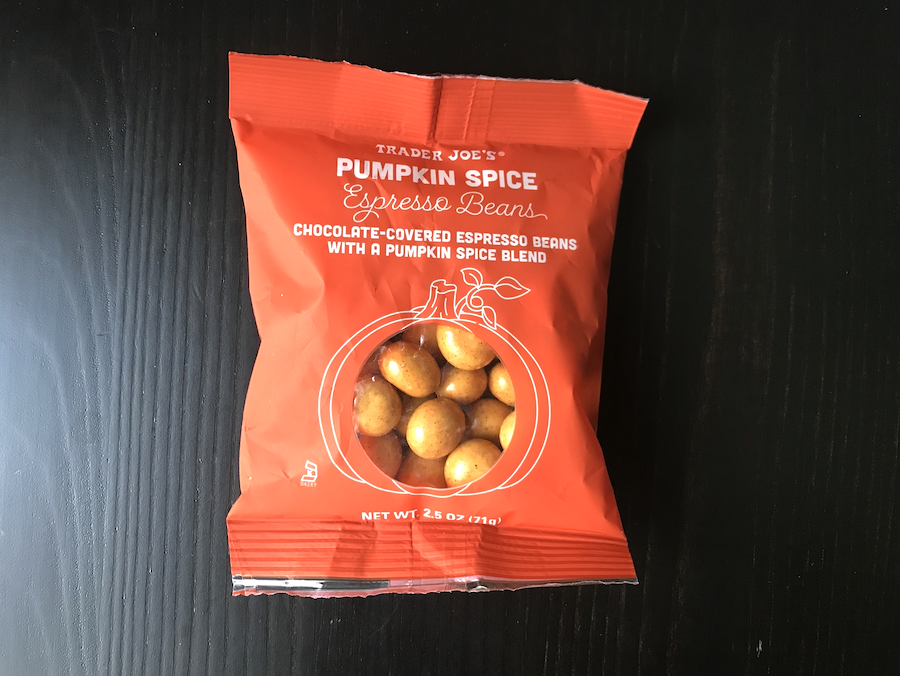 A bag of chocolate-covered espresso beans with a pumpkin spice blend