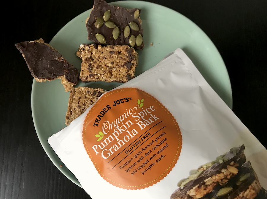 Pumpkin spice flavored granola layered with dark chocolate and topped with toasted pumpkin seeds