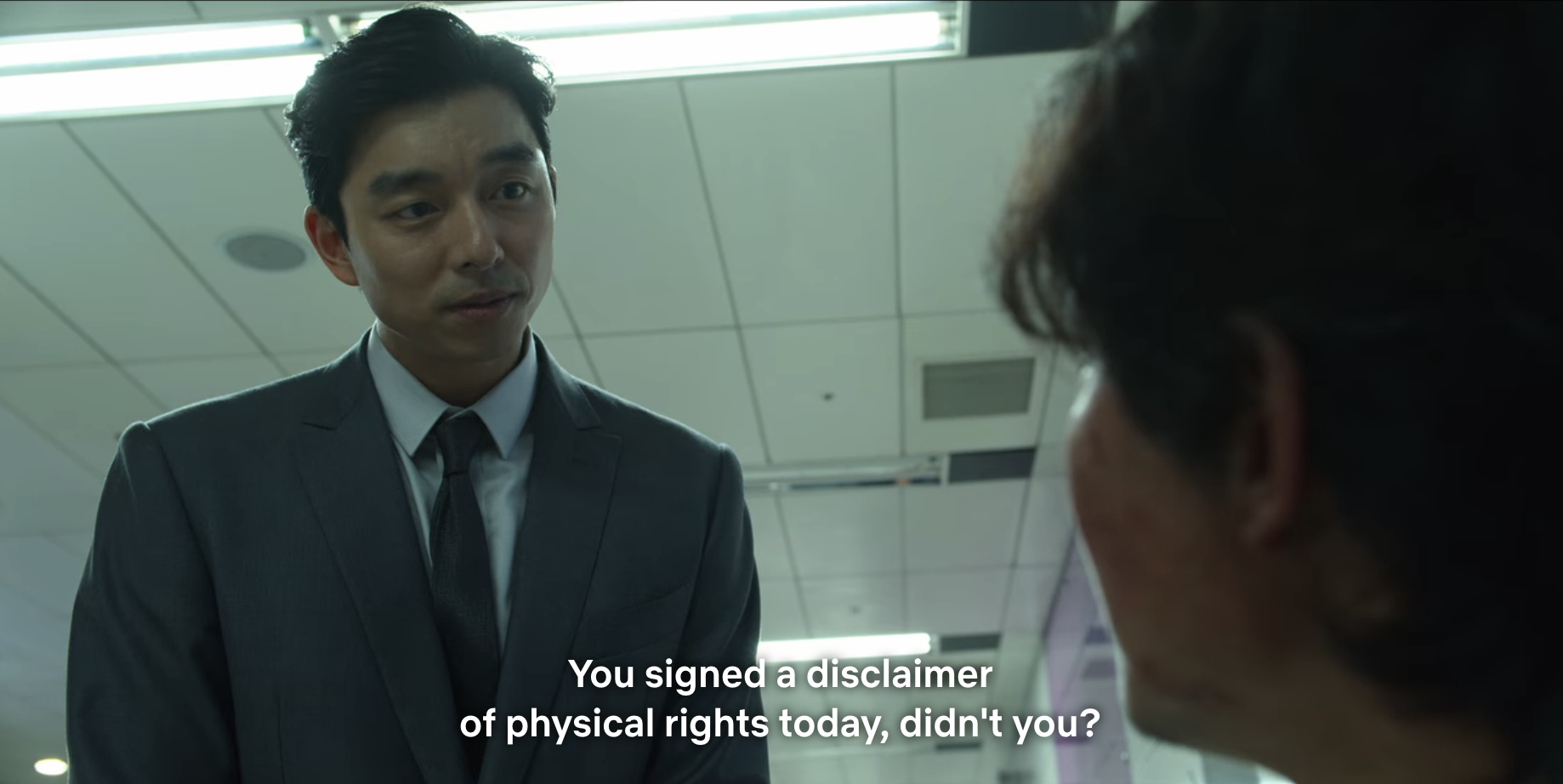 The man asking Gi-hun about the contract he signed