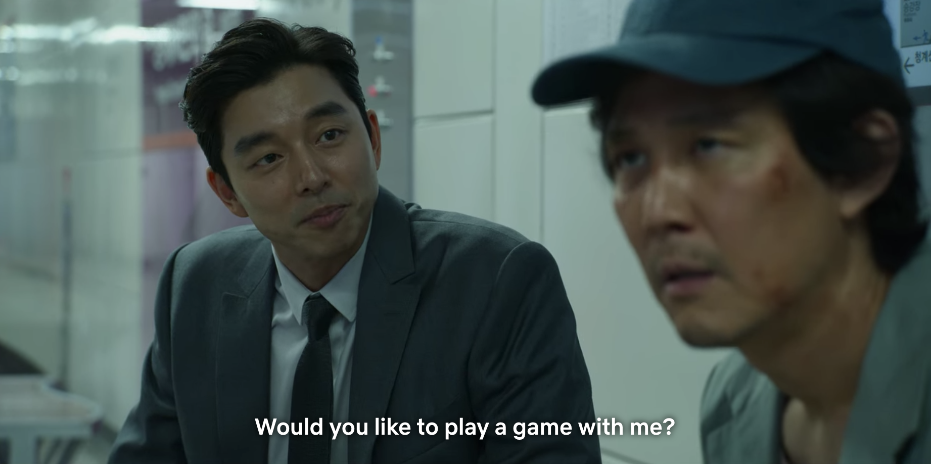 A man asking Gi-hun if he wants to play a game