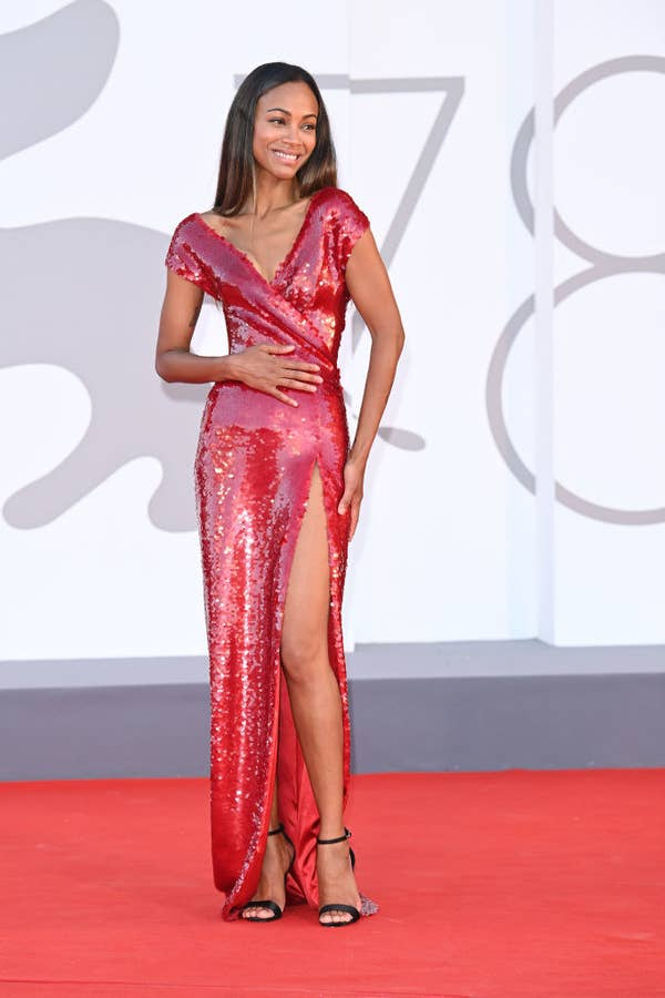 """Zoe Saldana wears a sparkingly red gown for the red carpet premiere of """"The Hand Of God"""""""