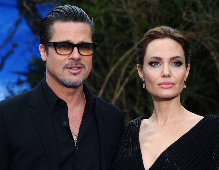 Brad and Angelina posing for photographers