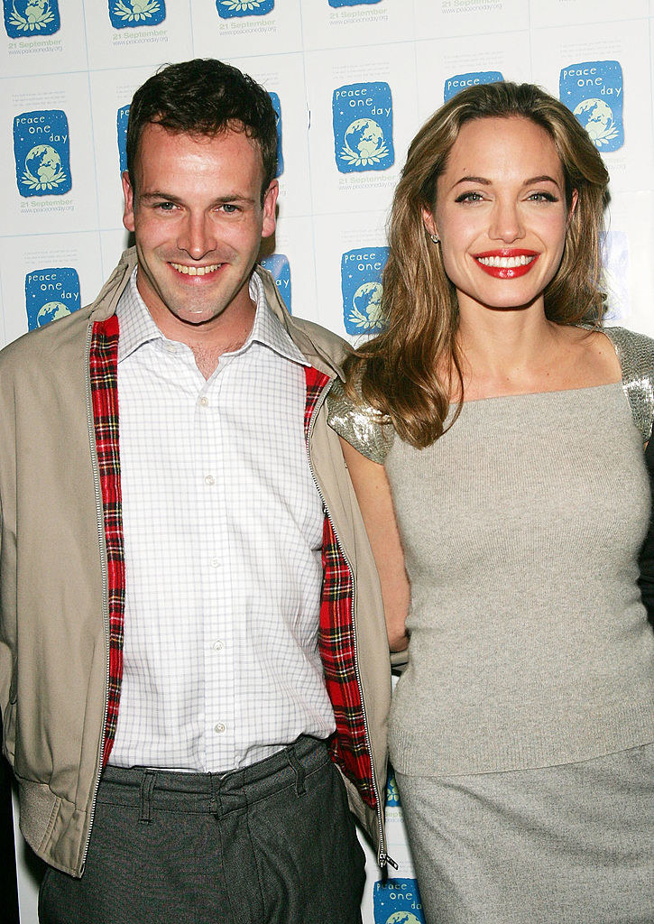 Johnny and Angelina smiling at an event for photographers