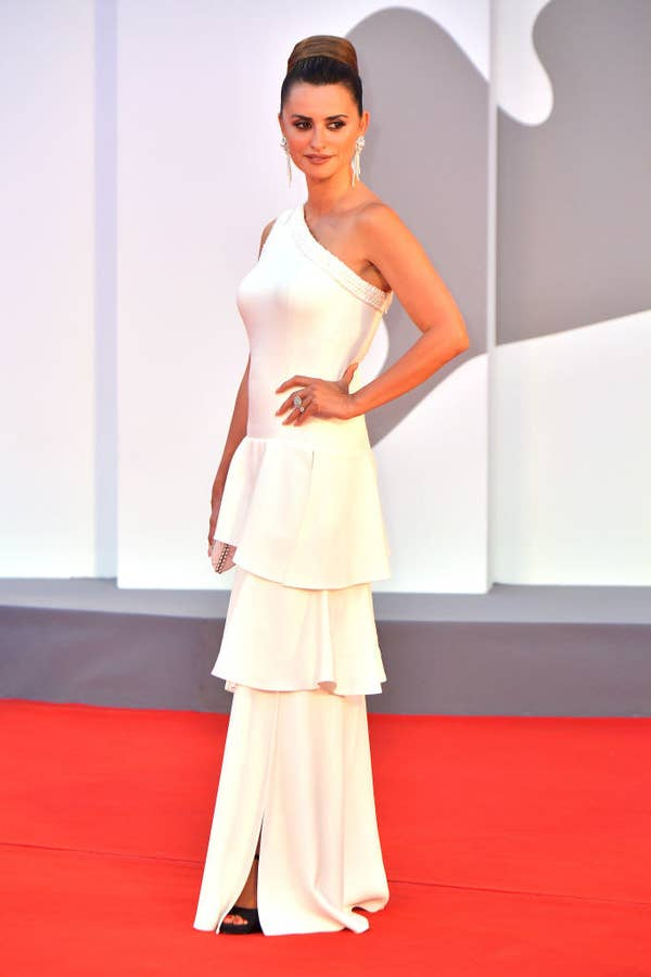 Penelope Cruz in a white satin gown with a slit on the red carpet