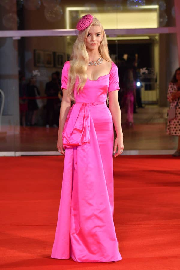 """Anya Taylor-Joy in a hot pink vintage gown and matching hat for the red carpet premiere of""""Last Night In Soho"""""""