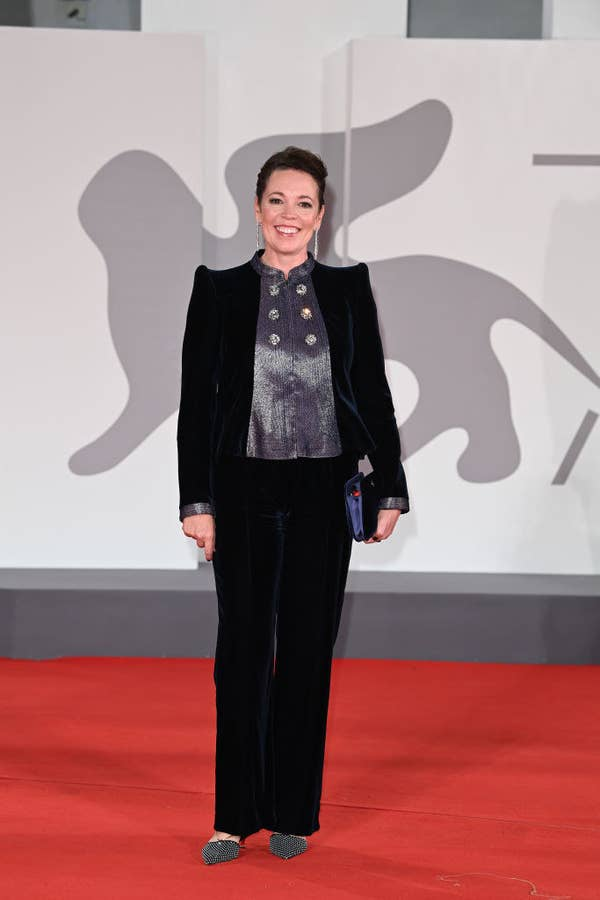 """Olivia Colman wearing a plush navy velvet suit with silver trimmings on the red carpet for """"The Lost Daughter"""""""