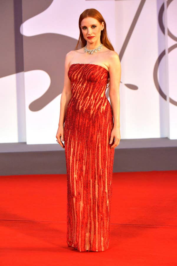 """Jessica Chastain in a red sequined patterned gown on the red carpet for HBO's """"Scenes From a Marriage (Ep. 1 and 2)"""""""
