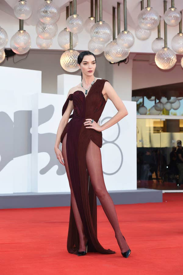 """Maria Carla Boscono in a cut out, geometric burgundy gown on the red carpet for """"Madres Paralelas"""""""