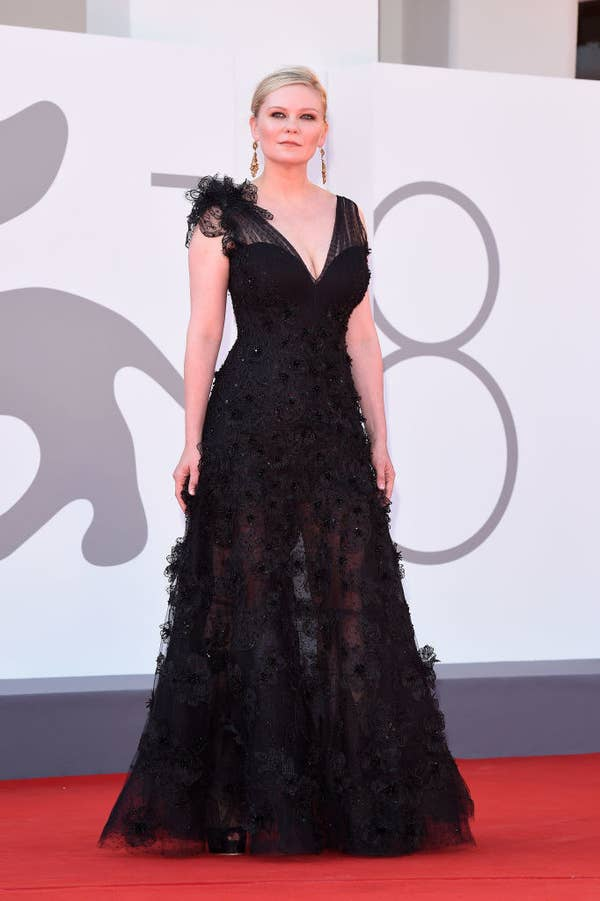 """Kirsten Dunst in a black lace gown with high shoulders on the red carpet for """"The Power Of The Dog"""""""