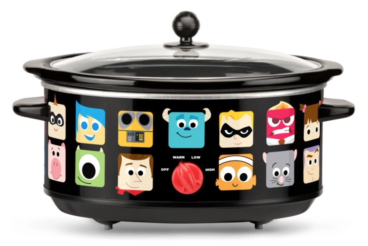 A slow cooker with Pixar character icons printed on the outside